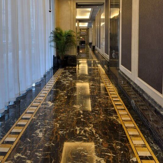 Black and gold marble floor combined with cream and yelow marble