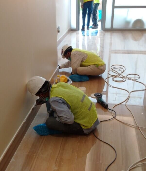 Albora workers at site, checking finishes after installtion, Hospital in Abu Dhabi